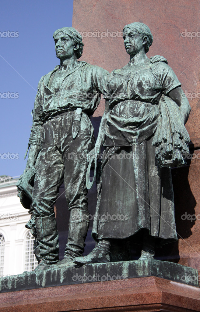 Statues at a pedestal of a monument to emperor Alexander II in Helsinki. — Stock Photo #1163358