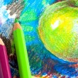 Child drawing by colored pencils - Stock Photo