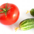 Still life with tomato and cucumbers — Stock Photo