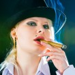 Royalty-Free Stock Photo: Smokes a cigar