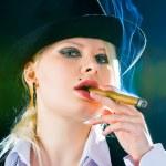 Постер, плакат: Smokes a cigar