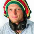 Rasta cap and earpiecess - Stock Photo