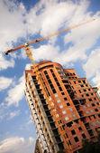 Building and crane — Stock Photo