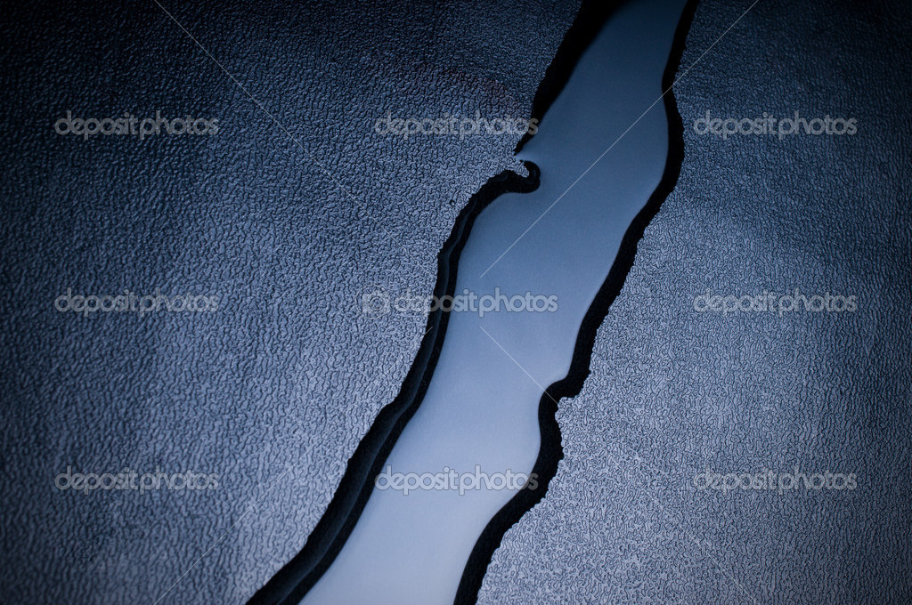 The liquid flows down on a black background — Stock Photo #1134329