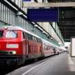 Train in the station with clock — Stock fotografie