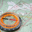 Stock Photo: Travel compass on map