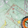 Travel compass on the map — Stock Photo