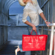 Blond with red bag 2 - Stock Photo