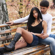 Stok fotoğraf: Couple sitting together on a bench