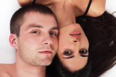 Young couple in love lying down — Stock Photo
