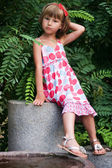 Little girl in a bright dress — Stock Photo