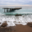 Sea landscape with ruined pier — Stock Photo