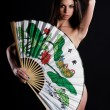 Sexy young woman with bright fan — Stock Photo #1495387
