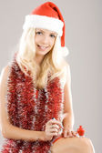 Pretty young woman preparing for xmas — Stock Photo