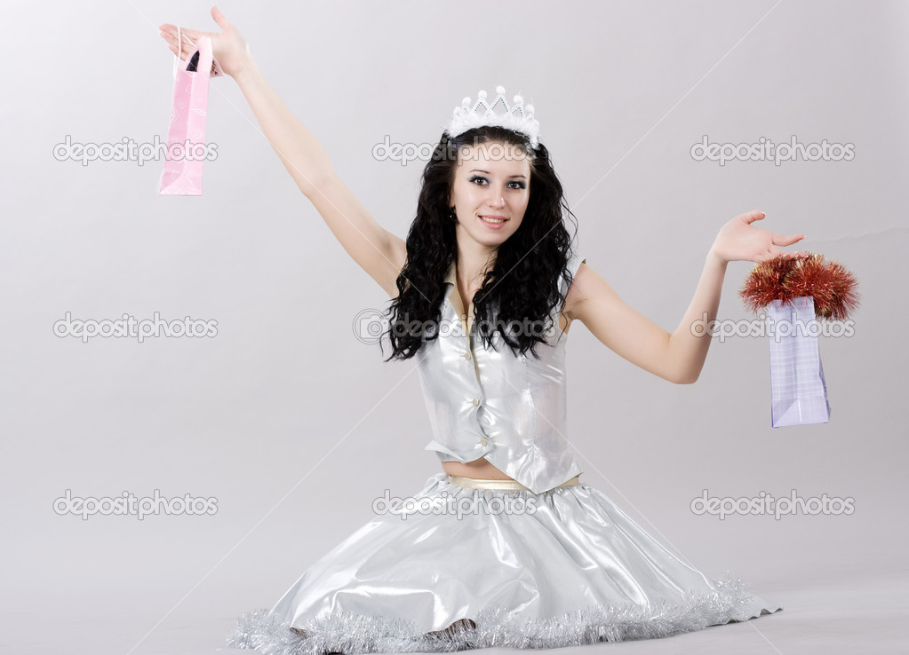 Beautiful little princess with christmass bags  Stock Photo #1495241