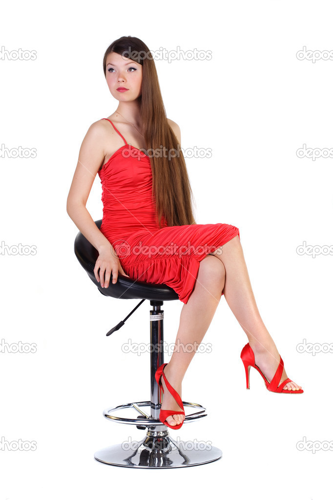 Beautiful young woman on a chair — Stock Photo #1507285