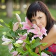 Beautiful young woman with lilies — Stock Photo #1535296