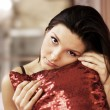 Stock Photo: Beautiful young woman with a pillow