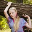 Stock Photo: Pretty young girl near a tree
