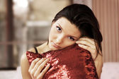 Beautiful young woman with a pillow — Stockfoto