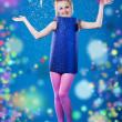 Happy carnival girl isolated on blue - Stock Photo