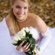 Bride sitting in a park — Stock Photo