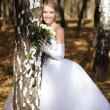 Bride in a park — Stock Photo