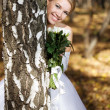 Stock Photo: Bride in a park