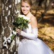 Bride in a park — Stock Photo #1901714