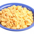 Corn-flakes on dark blue plate. — Stock Photo #1100779