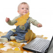 Boy plays with the laptop — Stock Photo
