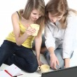 Two girls-students work on the laptop — Stock Photo #1102325