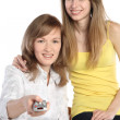Two girls with the panel from the TV — Stock Photo #1103014