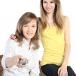 Two girls with the panel from the TV — Stock Photo