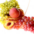 Grapes clusters, peaches and apple. - Stock Photo