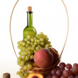 Royalty-Free Stock Photo: Basket with fruit and a wine bottle