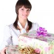 Girl with gift box in hands. — Stockfoto