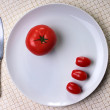 Stock Photo: Three small tomatos