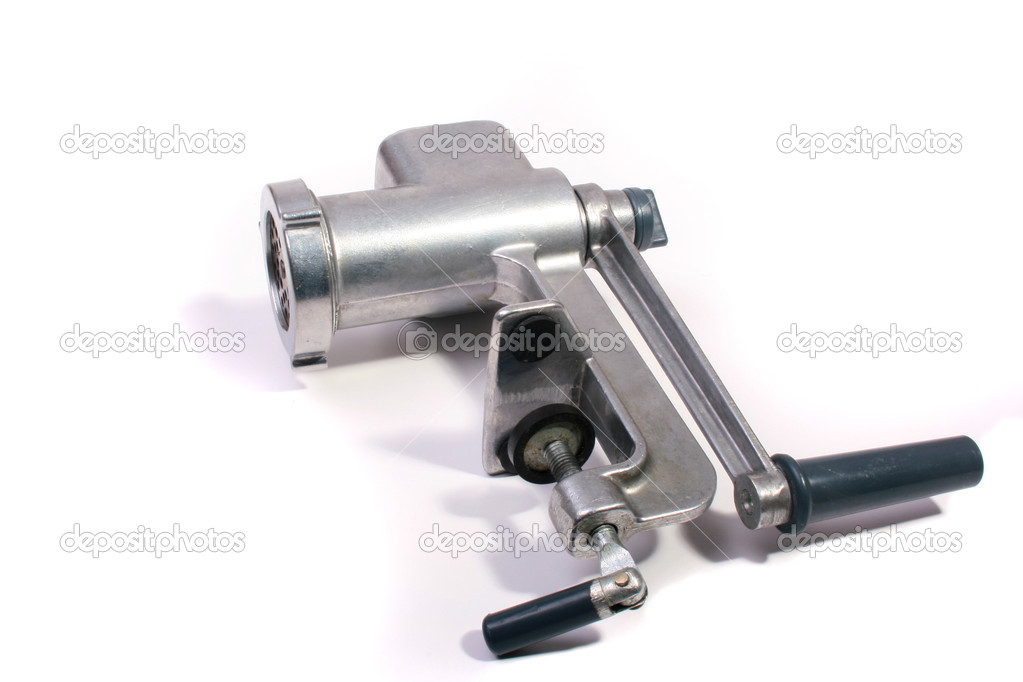 The disassembled meat grinder on a white background.  Stock Photo #1122334