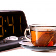 Electronic clock and tea — Stock Photo