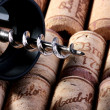 Corkscrew and stoppers — Stock Photo #1359198
