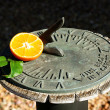 Royalty-Free Stock Photo: Tangerine with sundial