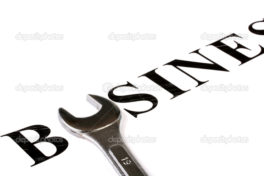 Word Business in which the letter U is replaced with a wrench. — Stock Photo #1507502