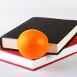 Books and orange — Stock Photo