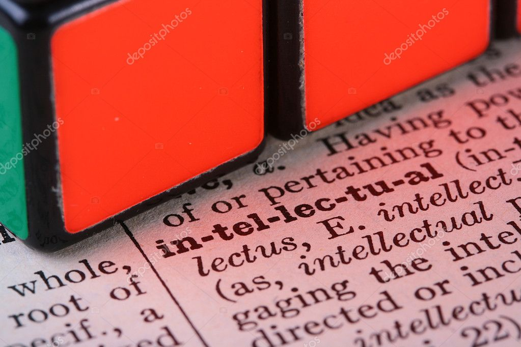 Word the intellectual it is united with a cube a puzzle.  Stock Photo #2513776