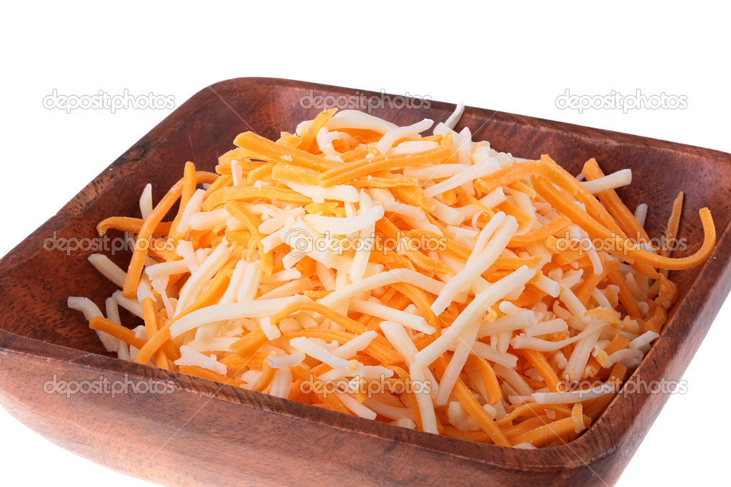Two grades of firm cheese are grated in a wooden plate. — Stock Photo #2641539