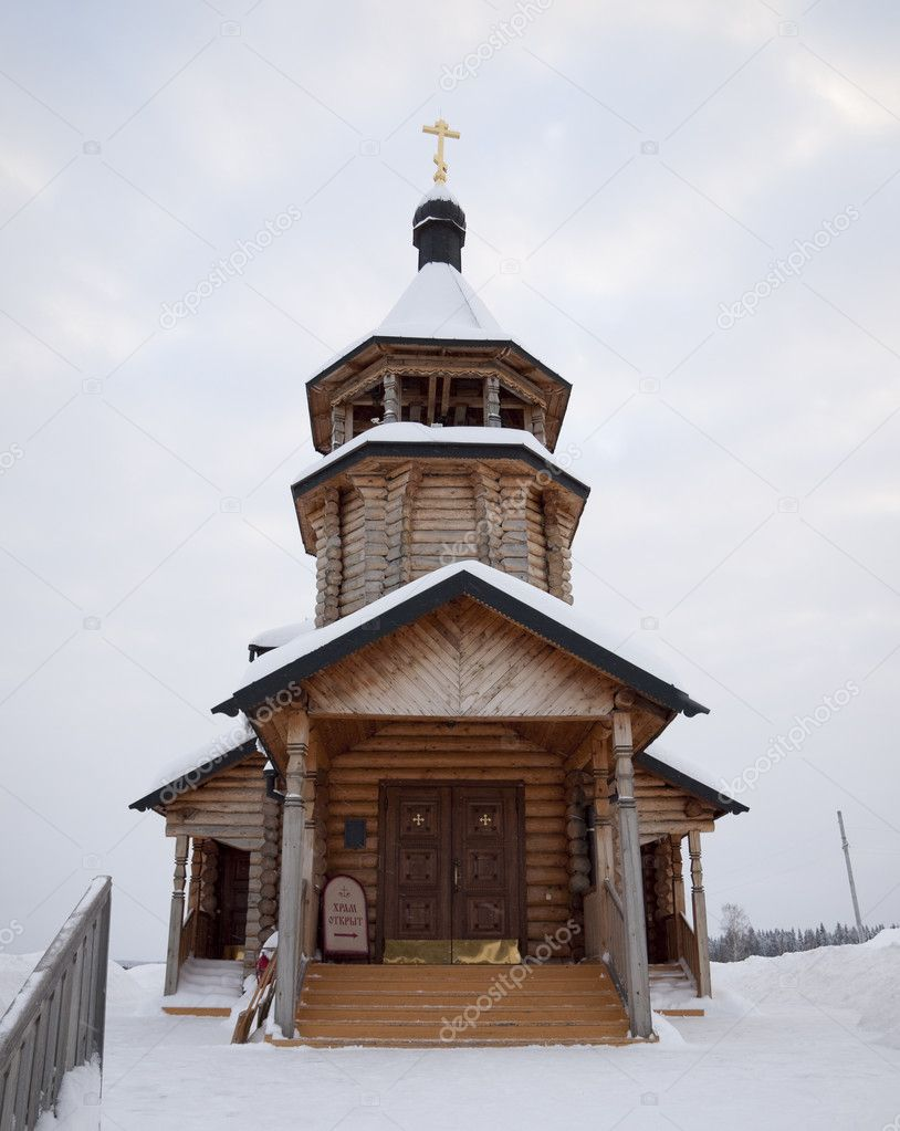 The wooden church brought by a snow.  Stock Photo #1585261