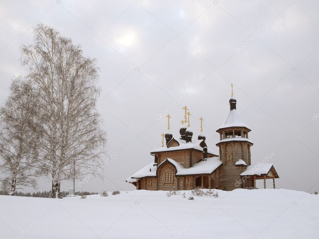 The wooden church brought by a snow. — Stock Photo #1586319