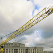 Stock Photo: The crane against clouds