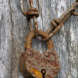 Rusty chain with old padlock - Stock Photo
